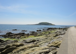 Hannafore Beach with Looe Island Nature Reserve in the background.