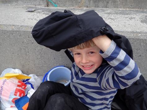 Cornish Rock Pools junior makes his picnic shelter.