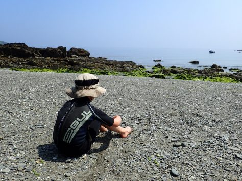 Cornish Rock Pools junior drying off in the sunshine at Port Nadler, near Looe.
