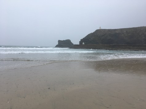 Portreath in the drizzle as the tide drops